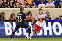 Eric Alexander (12) of the New York Red Bulls is marked by Fabio Alves (Fabinho) (33) of the Philadelphia Union. The New York Red Bulls and the Philadelphia Union played to a 0-0 tie during a Major League Soccer (MLS) match at Red Bull Arena in Harrison, NJ, on August 17, 2013.
