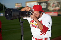 Springfield Cardinals pitcher Iden Nazario (39) takes photos with Nikon D4s and 400mm 2.8 lens before a game against the Frisco RoughRiders  on June 4, 2015 at Hammons Field in Springfield, Missouri.  Frisco defeated Springfield 8-7.  (Mike Janes/Four Seam Images)