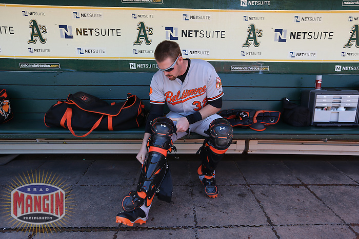 OAKLAND, CA - APRIL 28:  Matt Wieters #32 of the Baltimore Orioles gets ready in the dugout before the game against the Oakland Athletics on Sunday, April 28, 2013 at The O.co Coliseum in Oakland, California. Photo by Brad Mangin