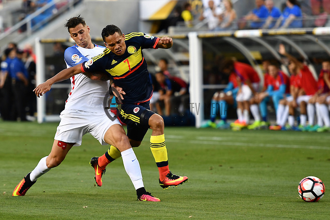 United States defender Geof Cameron (20) and Colombia forward Carlos Bacca (7) battle for the ball during Copa America Centenario match, in Santa Clara, CA. Friday, Jun 03, 2016. Colombia won 2-0. (TFV Media via AP) *Mandatory Credit*