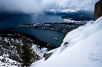 Elyse Saugstad skiing above Emerald Bay as a storm blows in. Lake Tahoe, CA