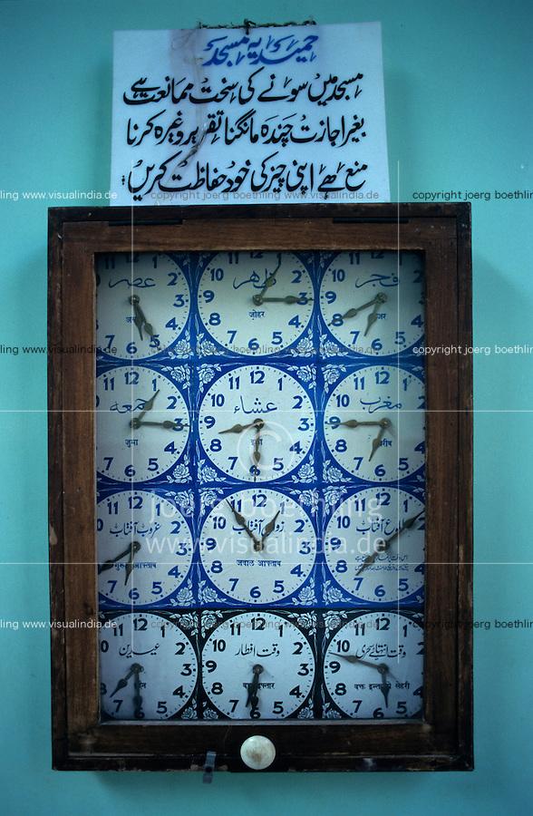 INDIA Mumbai, clocks with several timings in mosque / INDIEN Mumbai, Uhren mit Uhrzeiten an verschiedenen Orten in einer Moschee