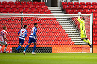 6th February 2021; Bet365 Stadium, Stoke, Staffordshire, England; English Football League Championship Football, Stoke City versus Reading; Goalkeeper Rafael of Reading makes an early save