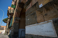 """First Building and area of Garbatella.<br /> <br /> Rome, 25/04/2020. Today, to mark the 75th Anniversary of the Italian Liberation from nazi-fascism (Liberazione) in Rome, I documented backwards the route of the annual march (Corteo) from Garbatella (South Rome's District in the VIII Municipio / Municipality which in 2020 celebrates 100 years from its foundation) to Piazzale Ostiense (1.) where usually a rally took place attended by Partizans / Partigiani (2.), Veterans and politicians. This year people were not allowed to attend the Commemoration (held with just a delegation of WWII Italian Partizans / Partigiani - including ANPI (3.) - along with the Mayor of Rome and few other Institutional Representatives) due to the spread of the 2019-20 Coronavirus pandemic (SARS-CoV-2 – infection: COVID-19, 5.) which already killed more than 200,000 people in the world (Data by WHO / OMS). The day ended with a flashmob held from the windows of Garbatella's Palladium (6.), where people sang two of the most famous Partizans / Partigiani's Anthems: Bella Ciao and Fischia Il Vento, the Italian Anthem """"Il Canto Degli Italiani / Inno d'Italia / Inno di Mameli"""", and few other songs (4.) which celebrate and remember the Partisans / Partigiani, their Sacrifice for the Freedom, the Italian Constitution, and the Future of Italy and Europe without fascisms and dictatorships.<br /> <br /> Footnotes & Links:<br /> 1. (25 Aprile 2018) http://tiny.cc/dsi3nz<br /> 2. (I Partigiani) http://tiny.cc/cwi3nz<br /> 3. http://www.anpi.it<br /> 4. Video (Source, Repubblica.it) : http://tiny.cc/3yi3nz<br /> 5. Rome's Lockdown: http://tiny.cc/d3i3nz & http://tiny.cc/w5i3nz <br /> 6. (Source, Wikipedia.org ENG) http://tiny.cc/6fm3nz <br /> (Liberazione: Source, Wikipedia.org ENG) http://tiny.cc/l9i3nz"""