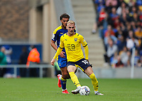4th September 2021; Merton, London, England;  EFL Championship football, AFC Wimbledon versus Oxford City: Mark Sykes of Oxford United passing the ball into midfield