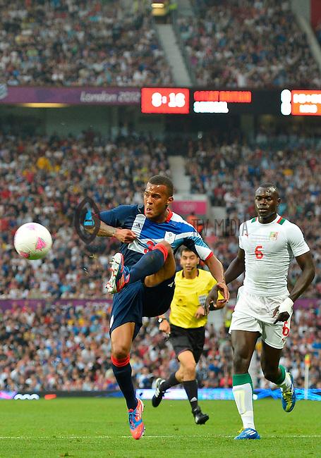 July 26, 2012..Britain's Ryan Bertrand (3) and Senegal's Zargo Toure (6). Great Britain vs Senegal Football match during 2012 Olympic Games at Old Trafford in Manchester, England. Senegal held Great Britain to a 1-1 draw...(Credit Image: © Mo Khursheed/TFV Media)