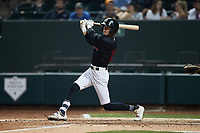 Duke Ellis (11) of the Winston-Salem Warthogs follows through on his swing against the Jersey Shore BlueClaws at Truist Stadium on July 21, 2021 in Winston-Salem, North Carolina. (Brian Westerholt/Four Seam Images)