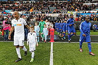 Andre Ayew of Swansea City (L) leads team mates out of the tunnel during the Premier League game between Swansea City v Chelsea at the Liberty Stadium, Swansea, Wales, UK. Saturday 28 April 2018