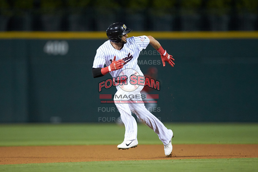 Paulo Orlando (16) of the Charlotte Hornets hustles towards third base against the Louisville Bats at BB&T BallPark on June 22, 2019 in Charlotte, North Carolina. The Hornets defeated the Bats 7-6. (Brian Westerholt/Four Seam Images)