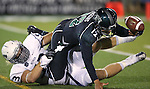 Nevada's Brock Hekking (53) forces Hawaii's Jeremy Higgins (12) to fumble, which led to a Nevada touchdown during the second half of an NCAA college football game in Reno, Nev., on Saturday, Sept. 21, 2013. Nevada won 31-9. (AP Photo/Cathleen Allison)
