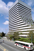 "Burnaby, BC, British Columbia, Canada - Telus Head Office Building (aka ""The Boot"") on Kingsway, Transit Bus on Road"