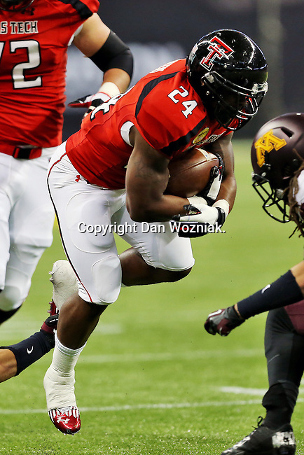 Texas Tech Red Raiders running back Eric Stephens Jr. (24) in action during the Meineke Car Care Bowl game of Texas between the Texas Tech Red Raiders and the Minnesota Golden Gophers at the Reliant Stadium in Houston, Texas. Texas leads Minnesota 24 to 17 at halftime.