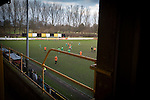 Prescot Cables 2 Brighouse Town 1, 13/02/2016. Hope Street, Northern Premier League. Spectators in the enclosure watching the second-half action as Prescot Cables (in orange) take on Brighouse Town in a Northern Premier League division one north fixture at Valerie Park. Founded in 1884, the 'Cables' in their name came from the largest local employer, British Insulated Cables and they have played in their current ground, also known as Hope Street, since 1906. Prescott won the match 2-1 watched by a crowd of 189. Photo by Colin McPherson.