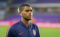 ORLANDO, FL - NOVEMBER 15: Reggie Cannon #20 of the United States walks onto the field during a game between Canada and USMNT at Exploria Stadium on November 15, 2019 in Orlando, Florida.
