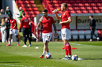 24th April 2021, Oakwell Stadium, Barnsley, Yorkshire, England; English Football League Championship Football, Barnsley FC versus Rotherham United; Alex Mowatt of Barnsley and Michał Helik of Barnsley taking a drink in the sunny conditions ahead of kick off