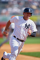 New York Yankees catcher Austin Romine (43) running the bases during a Spring Training game against the Detroit Tigers on March 2, 2016 at George M. Steinbrenner Field in Tampa, Florida.  New York defeated Detroit 10-9.  (Mike Janes/Four Seam Images)