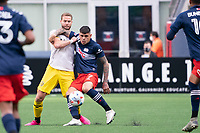 FOXBOROUGH, MA - MAY 16: Gustavo Bou #7 of New England Revolution battles Josh Williams #3 Columbus SC for the ball during a game between Columbus SC and New England Revolution at Gillette Stadium on May 16, 2021 in Foxborough, Massachusetts.