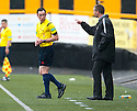 Alloa Manager Barry Smith continues to argue with referee Colin Steven despite being warned.