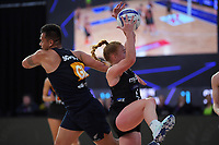 Silver Ferns wing defence Sam Winders takes a pass under pressure during the Cadbury Netball Series match between NZ Silver Ferns and NZ Men at the Fly Palmy Arena in Palmerston North, New Zealand on Thursday, 22 October 2020. Photo: Dave Lintott / lintottphoto.co.nz