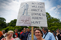 Pictured: A Labour party supporter with an anti-Jeremy Hunt placard. Sunday 01 July 2018<br /> Re: Labour Party leader Jeremy Corbyn at the celebration for the 70 years since the National Health Service (NHS) was founded by Aneurin Bevan, Bedwellty Park, Tredegar, Wales, UK.