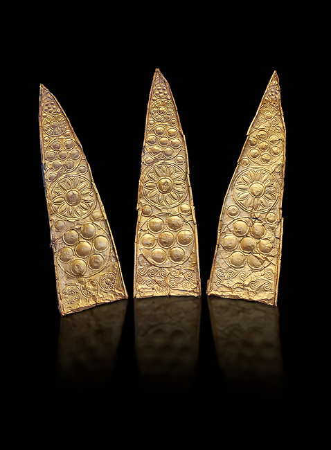 Top leaf shapes of a gold diadem from Grave III, 'Grave of a Women', Grave Circle A, Myenae, Greece. National Archaeological Museum Athens. Black Background<br /> <br /> Shaft Grave III, the so-called 'Grave of the Women,' contained three female and two infant interments. The women were literally covered in gold jewelry and wore massive gold diadems, while the infants were overlaid with gold foil.