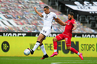 Ben Cabango of Swansea City vies for possession with Nahki Wells of Bristol City during the Sky Bet Championship match between Swansea City and Bristol City at the Liberty Stadium in Swansea, Wales, UK. Saturday 18 July 2020