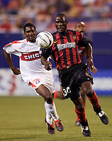 The MetroStars' Tenywa Bonseu is chased by the Chicago Fire's Damani Ralph. The Chicago Fire played the NY/NJ MetroStars to a one all tie at Giant's Stadium, East Rutherford, NJ, on May 15, 2004.