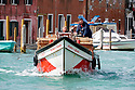 In Venice, many commercial deliveries also have to be made by boat through the city's waterways.