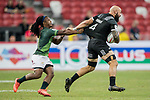 Branco Du Preez of South Africa tries to stop DJ Forbes of New Zealand, who runs with the ball during the match South Africa vs New Zealand, Day 2 of the HSBC Singapore Rugby Sevens as part of the World Rugby HSBC World Rugby Sevens Series 2016-17 at the National Stadium on 16 April 2017 in Singapore. Photo by Victor Fraile / Power Sport Images