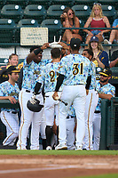 Bradenton Marauders Sammy Siani (25) greeted at the dugout by teammates Alexander Mojica (28), Maikol Escotto (35), and Domingo Gonzalez (31) after hitting a home run during a game against the Daytona Tortugas on June 12, 2021 at LECOM Park in Bradenton, Florida.  (Mike Janes/Four Seam Images)