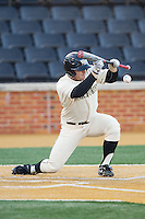 Jack Carey (20) of the Wake Forest Demon Deacons lays down a bunt against the Towson Tigers at Wake Forest Baseball Park on February 15, 2014 in Winston-Salem, North Carolina.  (Brian Westerholt/Four Seam Images)
