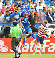 Nick Rimando (1) of the USMNT goes up to make a save against Victor Turcios (3) of El Salvador.  The USMNT defeated El Salvador 5-1 at the quaterfinal game of the Concacaf Gold Cup, M&T Stadium, Sunday July 21 , 2013.