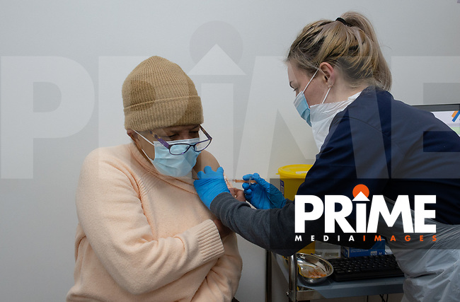 A  group 4 female patient receives her COVID-19 vaccination at Aspire Pharmacy, Hadlow Road, Sidcup, Kent, England on the 8 February 2021. Photo by Alan Stanford.