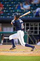 Northwest Arkansas Naturals center fielder Donald Dewees Jr. (16) follows through on a swing during a game against the Midland RockHounds on May 27, 2017 at Arvest Ballpark in Springdale, Arkansas.  NW Arkansas defeated Midland 3-2.  (Mike Janes/Four Seam Images)