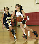 SOUTHBURY, CT, 01/02/08- 010208BZ01- Pomperaug's Lauren Atkinson (10) drives past the defense of Notre Dame's Ashley Tranquillo during their game at Pomperaug High School in Southbury Wednesday night.<br /> Jamison C. Bazinet Republican-American