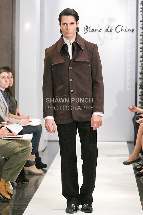 """Model walks runway in an outfit from the Blanc de Chine Fall/Winter 2011 """"The Five Elements"""" collection, during New York Fashion Week Fall 2011."""