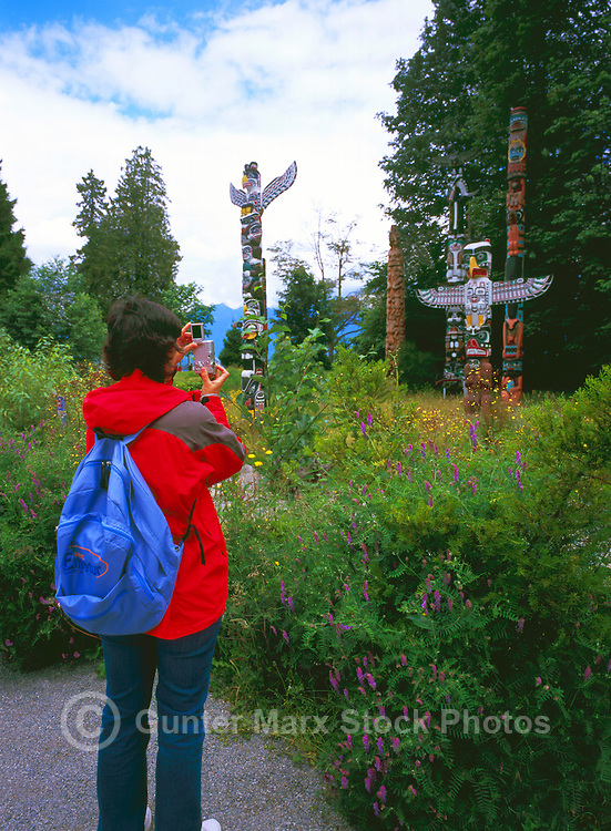 Stanley Park, Vancouver, BC, British Columbia, Canada - Tourist taking Picture of Totem Poles at Brockton Point