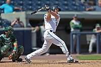 West Michigan Michigan Whitecaps third baseman Josh Lester (32) follows through on his swing against the Fort Wayne TinCaps during the Midwest League baseball game on April 26, 2017 at Fifth Third Ballpark in Comstock Park, Michigan. West Michigan defeated Fort Wayne 8-2. (Andrew Woolley/Four Seam Images)