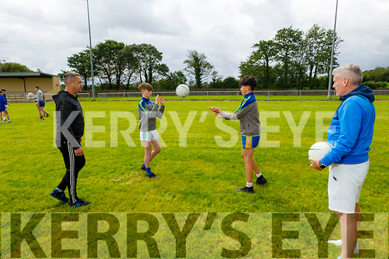 Coaches David Murphy and Jason Foley having a chat with juvenile players Oisin O'Dowd and Lochlan Shea as Keel GAA gets ready for the re opening of the club.