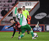 12th January 2021; Vitality Stadium, Bournemouth, Dorset, England; English Football League Championship Football, Bournemouth Athletic versus Millwall; Ryan Woods of Millwall competes for the ball with David Brooks of Bournemouth