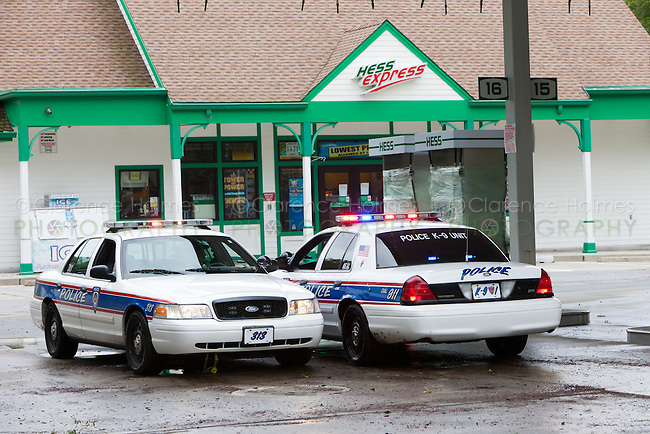 MAMARONECK, NY - AUGUST 28: Two Mamaroneck police cruisers stopped in a recently flooded gas station on Mamaroneck Avenue in the Village of Mamaroneck, New York on Sunday August 28, 2011 in the aftermath of Hurricane Irene.