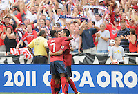 USMNT Clint Dempsey (8) celebrates with team mate Maurice Edu his score.   US Men's National Team  defeated Jamaica 2-0 in the quaterfinals for the 2011 CONCACAF Gold Cup , at RFK Stadium, Sunday June 19, 2011.