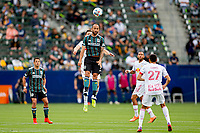 CARSON, CA - APRIL 25: Victor Vazquez #17 of the Los Angeles Galaxy heads a ball during a game between New York Red Bulls and Los Angeles Galaxy at Dignity Health Sports Park on April 25, 2021 in Carson, California.