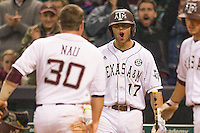 Texas A&M Aggie first baseman Logan Taylor #17 celebrates with teammate Mitchell Nau #30 after Nau scored against the Houston Cougars in the NCAA baseball game on March 1st, 2013 at Minute Maid Park in Houston, Texas. Houston defeated Texas A&M 7-6. (Andrew Woolley/Four Seam Images).