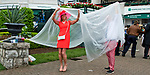 LOUISVILLE, KY - MAY 05: Fans hide under a tarp to get away from the downpour on Kentucky Derby Day at Churchill Downs on May 5, 2018 in Louisville, Kentucky. (Photo by Eric Patterson/Eclipse Sportswire/Getty Images)