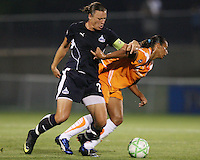 Abby Wambach#20 of the Washington Freedom crashes into Rosana#11 of Sky Blue FC during a WPS match at Maryland Soccerplex on August 8,2009 in Boyds, Maryland. Freedom won 3-1