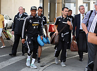 Wednesday 28 August 2013<br /> Pictured L-R: Jonathan de Guzman and Leon Britton arriving to Bucharest Airport in Romania.<br /> Re: Swansea City FC arrive to Romania for a press conference and training session, a day before their UEFA Europa League, play off round, 2nd leg, against Petrolul Ploiesti in Romania.