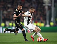 Football Soccer: UEFA Champions UEFA Champions League quarter final second leg Juventus - Ajax, Allianz Stadium, Turin, Italy, March 12, 2019. <br /> Juventus Leonardo Bonucci (r) in action with Ajax's Hakim Ziyech (l) during the Uefa Champions League football match between Juventus and Ajax  at the Allianz Stadium, on March 12, 2019.<br /> UPDATE IMAGES PRESS/Isabella Bonotto