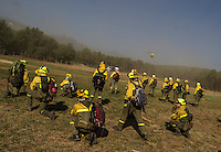 Members of the Brif, (reinforcement brigade wildfires) wait to be airlifted by helicopters to the wildfire in Tabuyo del Monte, near Leon on August 22, 2012. Spain's government Thursday denied crisis budget cuts had hit national resources for fighting this summer's spate of deadly wildfires. Numerous wildfires have broken out across Spain including a fire that has ravaged thousands of hectares on the Spanish island of La Gomera, part of the Canary Islands archipelago, in the sweltering heat in recent weeks. © Pedro ARMESTRE