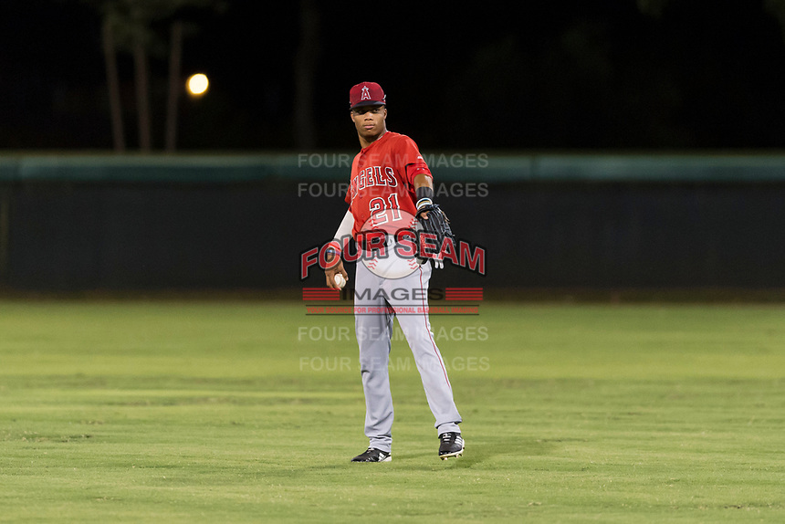 AZL Angels center fielder Jordyn Adams (21) warms up between innings of an Arizona League game against the AZL Dodgers at Camelback Ranch on July 8, 2018 in Glendale, Arizona. The AZL Dodgers defeated the AZL Angels by a score of 5-3. (Zachary Lucy/Four Seam Images)